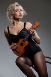 Young Woman With Ukulele Royalty Free Stock Photos
