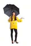 Young woman with umbrella. Isolated on white background Royalty Free Stock Image