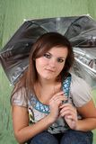 Young woman with an umbrella. Royalty Free Stock Image