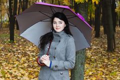 Young woman with umbrella Stock Photos