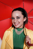 Young woman with umbrella. A well dressed young woman with a bright red umbrella Stock Photography