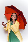 Young woman with umbrella. A well dressed young woman with a bright red umbrella Royalty Free Stock Images