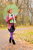 Young woman with umbrella in autumn park Royalty Free Stock Photos