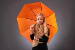 Young woman with an umbrella Royalty Free Stock Image