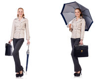 The young woman with umbrella isolated on white Stock Photos