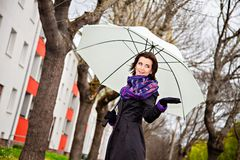 Young woman with umbrella looking for rain Royalty Free Stock Photography
