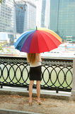 Young woman with umbrella near river Royalty Free Stock Photos