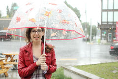 Young woman with umbrella. Standing in the rain Royalty Free Stock Photo