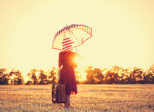 Young woman with umbrella and suitcase Royalty Free Stock Photography