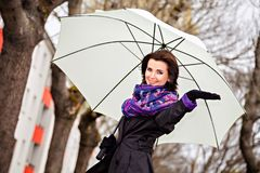 Young woman with umbrella waiting for the rain Royalty Free Stock Photo