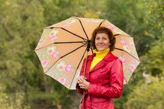 The young woman with an umbrella Stock Photo