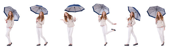 The young woman with umbrella on white Stock Image