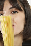 Young Woman With Uncooked Spaghetti Royalty Free Stock Photo