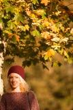Young woman under autumn tree Stock Photos