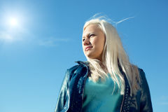 Young woman under blue sky. Pretty young woman under blue sky Stock Photo