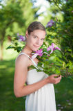 Young woman under a magnolia tree Stock Image