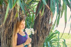 Young woman under the palm trees Royalty Free Stock Images