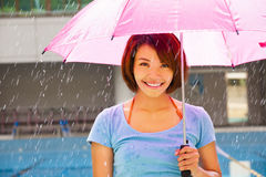 Young woman under pink umbrella Stock Image