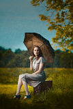 Young woman under rain Stock Images