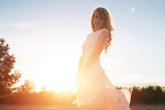 Young woman under sunset light, outdoors portrait. Royalty Free Stock Photography