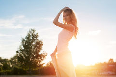 Young woman under sunset light, outdoors portrait. Royalty Free Stock Photos