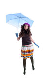 Young woman under an umbrella. Jumping over white - image full of movement Royalty Free Stock Images