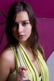 Young woman under an umbrella Royalty Free Stock Photos