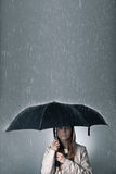Young woman under an umbrella during rainfall Stock Photo