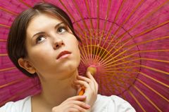 Young woman under wooden orient umbrella Royalty Free Stock Photo
