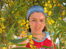 Young woman under yellow flower tree. Cyprus Island Stock Photography