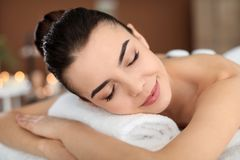 Young woman undergoing hot stone therapy. In spa salon Stock Images