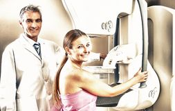 Young woman undergoing mammography with doctor supervision stock photography