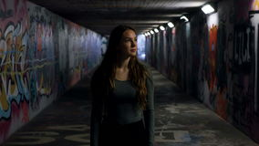 Young Woman in an Underpass stock video