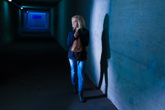 Woman in the tunnel is afraid Stock Photo