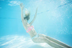 Young woman underwater in swimming pool. Royalty Free Stock Photo