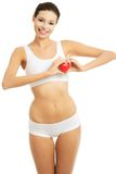 Young woman in underwear holding a heart model Stock Photography