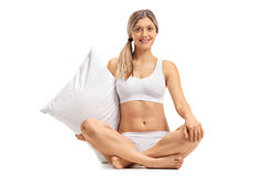 Young woman in underwear holding a pillow Royalty Free Stock Photography