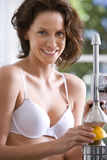 Young woman in underwear with juicer, smiling, portrait, close-up Royalty Free Stock Photos