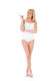 Young woman in underwear pointing to the side Royalty Free Stock Photography
