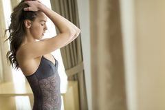 Young woman in underwear in room Stock Images