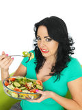 Young Woman Unhappy Expression Eating a Fresh Crisp Mixed Garden Salad Stock Images