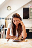 Young Woman Is Unhappy With Her Burnt Pizza For Lunch Stock Image