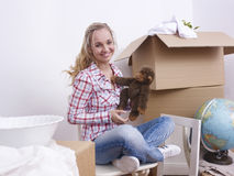 Young woman unpacking boxes Royalty Free Stock Photos
