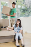 Young woman unpacking carton boxes Royalty Free Stock Photo