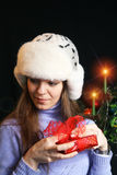Young Woman Unwrapping Christmas Gift Stock Image