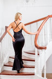 Young woman up the stairs Stock Image