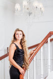 Young woman up the stairs Royalty Free Stock Images