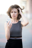 Young woman upset by phone call Royalty Free Stock Photography
