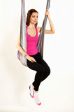 Young woman upside down doing anti-gravity aerial yoga. On white background stock photography