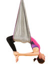 Young woman upside down doing anti-gravity aerial yoga. On white background royalty free stock images